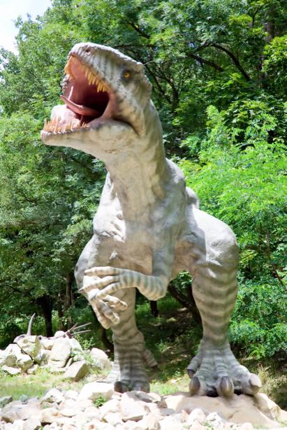 Фотообои динозавр тираннозавр на камнях (animals-0000149)